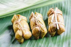 Rice steamed in green banana leaf Stock Photos