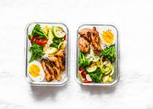 Rice, stewed vegetables, egg, teriyaki chicken - healthy balanced lunch box on a light background, top view. Home food for office royalty free stock image