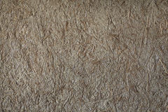 Rice straw on  Stone Wall Background Texture. Royalty Free Stock Photos