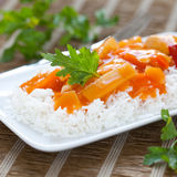 Rice with sweet sour chicken. Chinese rice meal with sweet sour chicken Royalty Free Stock Image