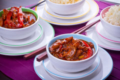 Rice and sweet and sour chicken. Chinese bowls with rice and sweet and sour chicken Stock Photography