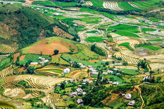 Rice terraces at planting season. Ethnic farmers grow rice on terraces on mountains, making very nice landscape.nLocation: Mu Cang Chai, Vietnam Stock Image
