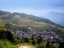 Rice terraces and village - China Royalty Free Stock Image