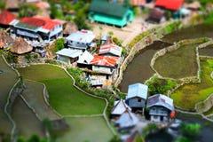 Rice terraces and village houses. Banaue, Philippines. Tilt shift. Amazing tilt shift effect view of rice terraces fields and village houses in Ifugao province stock images