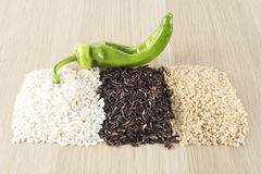 Rice thai black, brown rice, carnaroli rice. On wooden table, healthy lifestyle Stock Photography