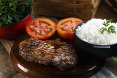 Rice, tomato and steak stock images