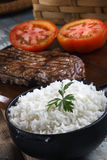 Rice, tomato and steak stock image