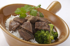 Rice topped with Chinese beef stew Stock Photos