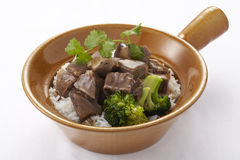 Rice topped with Chinese beef stew Stock Images