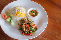 Rice topped fried egg with stir-fried pork and basil Royalty Free Stock Photography