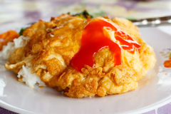 Rice topped with omelette. Stock Images
