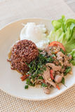 Rice topped with stir-fried beef and basil with  fried egg Royalty Free Stock Images