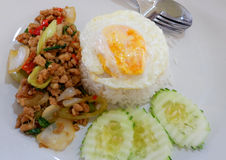 Rice topped with stir-fried pork and basil Stock Photos