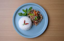 Rice topped with stir-fried pork and basil. Lemon leaf and chili are traditional of Thai food. More energy and fresh. Very spicy and salty but very good taste Royalty Free Stock Photo