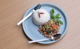 Rice topped with stir-fried pork and basil. Lemon leaf and chili are traditional of Thai food. More energy and fresh. Very spicy and salty but very good taste Stock Photos