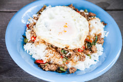 Rice topped with stir fried pork and basil with Royalty Free Stock Photography