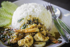 Rice topped with stir-fried shrimps and basil. At the restaurant Stock Photo