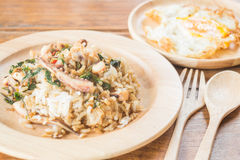 Rice topped with stir-fried squid basil and fried egg (Thai food Royalty Free Stock Photo