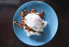 Rice topped with stir-fry pork and basil. Thai food royalty free stock image