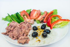 Rice, tuna chopped vegetables, olives. Rice tuna chopped vegetables and olives in a white plate on a white background Stock Images