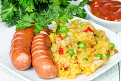 Rice with two grilled sausages Royalty Free Stock Photography