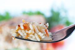 Rice with vegetable. On fork on white background Stock Photography