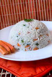 Rice with vegetables. Rice with different kind of vegetables and carrot slices Stock Photography