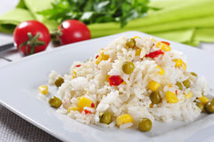 Rice with vegetables. Bowl of rice with peas, corn and red peppers Royalty Free Stock Photos