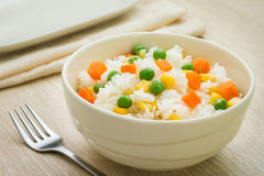 Rice with vegetables in bowl Stock Photography