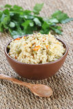 Rice with vegetables in a ceramic bowl on a mat Royalty Free Stock Photo