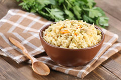 Rice with vegetables in a ceramic bowl Royalty Free Stock Photos
