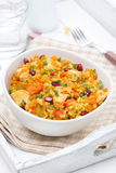 Rice with vegetables, chicken and pomegranate, vertical royalty free stock photo