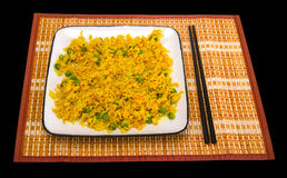 Rice with vegetables and chopsticks on bamboo mat Stock Photo