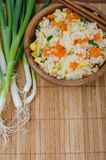 Rice with vegetables and empty background for notes Stock Photography