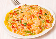 Rice with vegetables and fish Stock Images