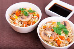 Rice with vegetables and mushrooms with soy sauce Stock Image