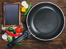 Rice with vegetables next to a frying pan Royalty Free Stock Photography