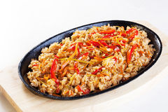 Rice with vegetables in a pan isolated cast iron wok Royalty Free Stock Photos