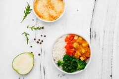 Rice with vegetables in a plate on a white background. Top view. Free space for your text royalty free stock photo