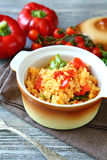 Rice with vegetables in a pot on boards Royalty Free Stock Image