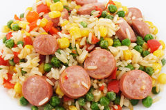 Rice with vegetables and sausages Stock Images