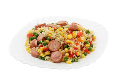 Rice with vegetables and sausages Stock Image