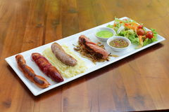 Rice with vegetables and seafood  two sausages Stock Photography