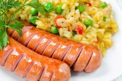 Rice with vegetables and two sausages Stock Photos