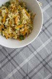Rice with vegetables vertical on chequered tablecloth Royalty Free Stock Photos