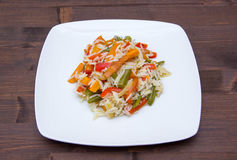 Rice with vegetables on wood Stock Photos