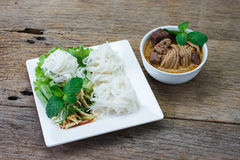 Rice vermicelli with chicken curry sauce and vegetables,select f Stock Image