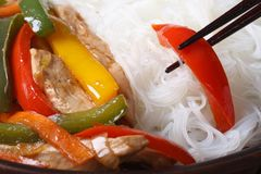 Rice vermicelli with chicken, vegetables and chopsticks. macro Stock Images