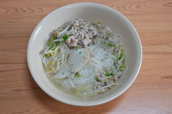 Rice vermicelli topping fish line and boiled minced pork in soup. On bowl Royalty Free Stock Images