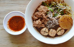 Rice vermicelli topping pork ball and meat in brown soup with spicy sauce Stock Photo